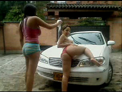 Two Colombian girl washing car on webcam